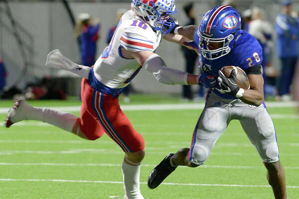 West Brook's Jakobi Holland looks to outpace Austin Westlake's Leo Lowin during the Class 6A state semifinals at Legacy Stadium. Photo taken Saturday, December 15, 2018 Kim Brent/The Enterprise