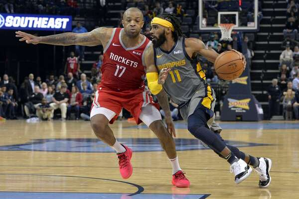 Memphis Grizzlies guard Mike Conley (11) drives against Houston Rockets forward PJ Tucker (17) in the second half of an NBA basketball game Saturday, Dec. 15, 2018, in Memphis, Tenn. (AP Photo/Brandon Dill)