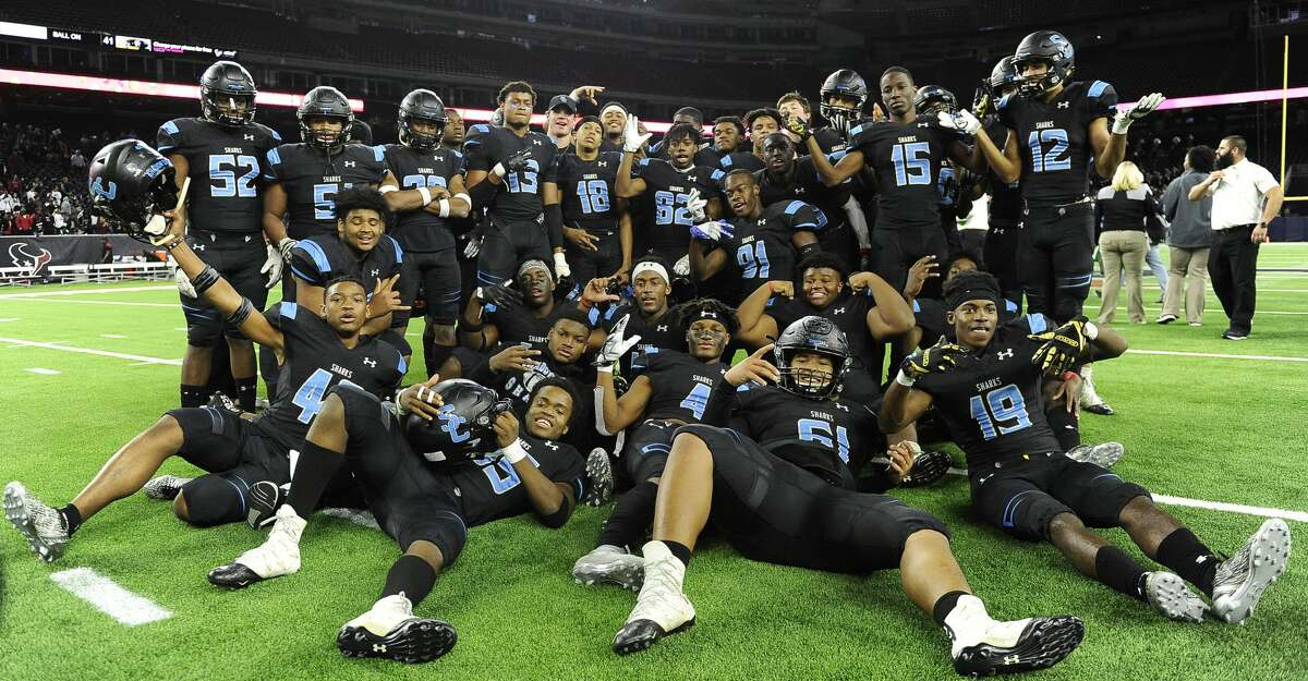 Shadow Creek players pose after their win over Wagner in a 5A Division 1 state semi-final high school football playoff game, Saturday, Dec. 15, 2018, in Houston.