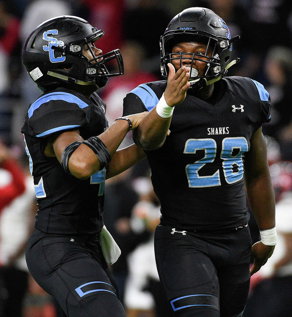 Shadow Creek Jayveon Bell, right, celebrates his fumble recovery with linebacker Raphael Joiner during the second half of a 5A Division 1 state semi-final high school football playoff game against Wagner, Saturday, Dec. 15, 2018, in Houston.