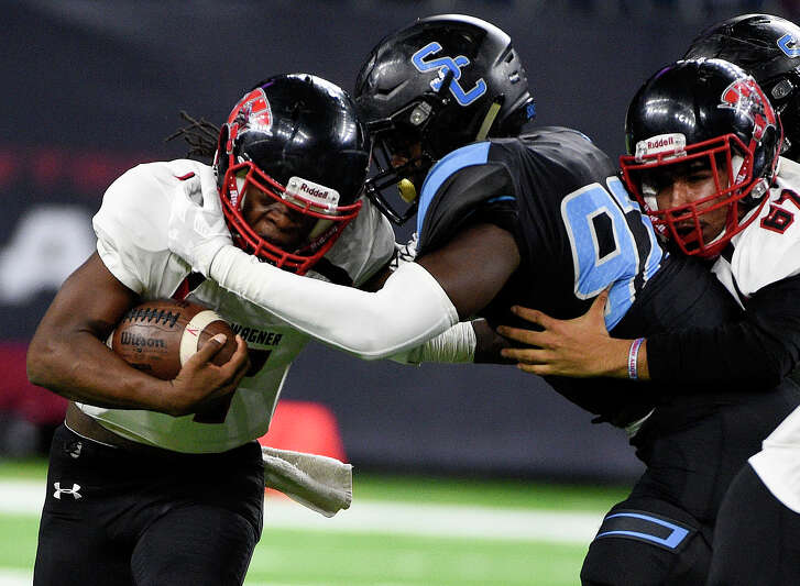 Wagner quarterback Javion Ray, left, is tackled by Shadow Creek defensive lineman Alec Bryant during the first half of a 5A Division 1 state semi-final high school football playoff game, Saturday, Dec. 15, 2018, in Houston.