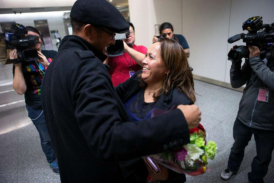 Maria Mendoza-Sanchez (right) hugs her Highland Hospital co-worker Harinet Shale at SFO on Saturday, Dec. 15, 2018, in San Francisco, Calif. Mendoza-Sanchez, a nurse who was separated from her children and deported to Mexico last year after more than two decades in Oakland, won her improbable fight to return to the United States. Her visa was approved by U.S. Citizenship and Immigration Services. Photo: Santiago Mejia / The Chronicle