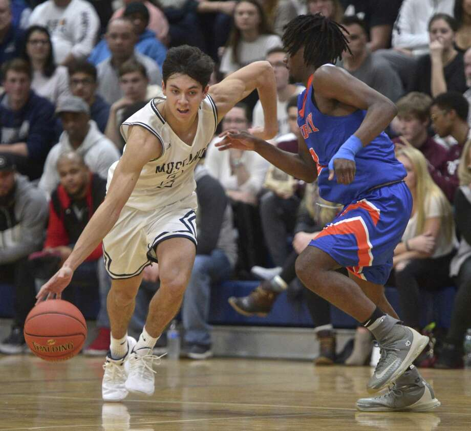 Immaculate's Mikey Basile (2) drives by Danbury's Keyon Moore (3) in the 2018 News Times 19th annual boys high school Tip Off Classic basketball tournament championship game between Danbury and Immaculate high schools. Saturday night, December 15, 2018, at Immaculate High School, Danbury, Conn. Photo: H John Voorhees III / Hearst Connecticut Media / The News-Times