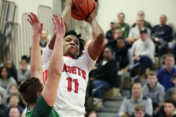Albany Academy's Rob Brown takes a shot at the basket during a game against Bishop Ludden Saturday Dec. 15, 2018 at Albany Academy.
