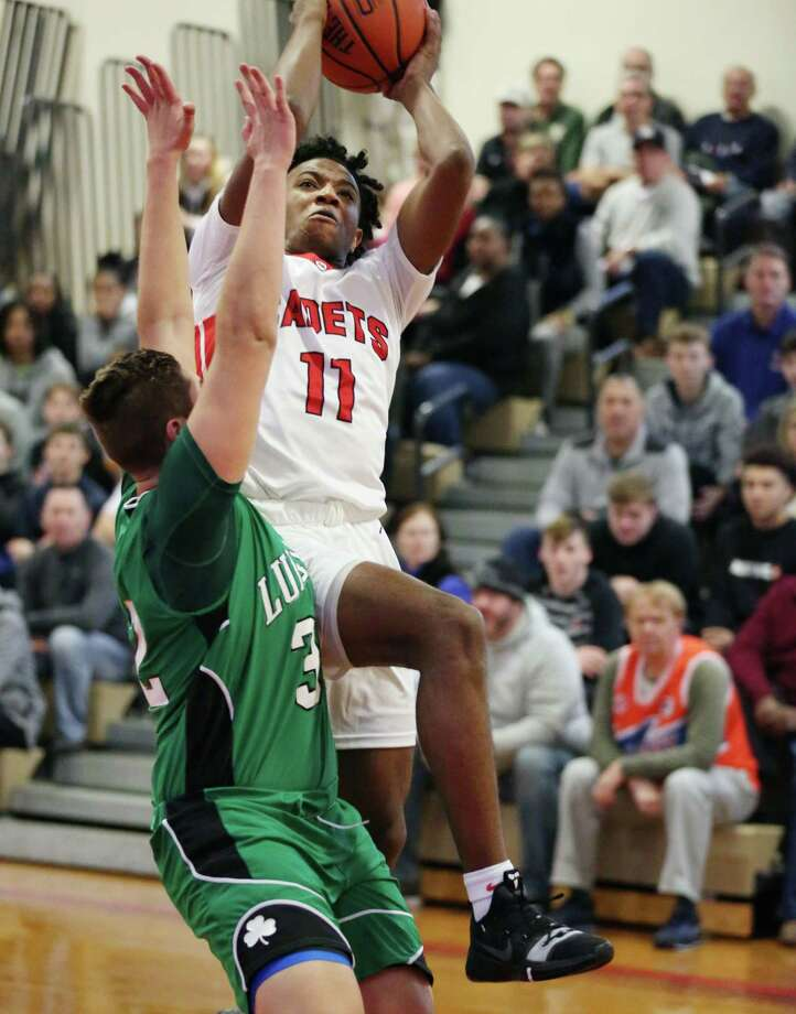 Albany Academy's Rob Brown takes a shot at the basket during a game against Bishop Ludden Saturday Dec. 15, 2018 at Albany Academy. Photo: Phoebe Sheehan