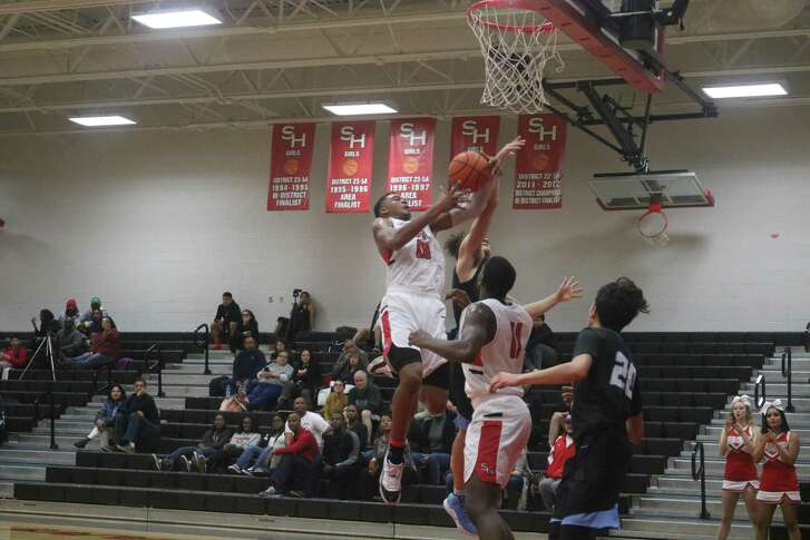 South Houston's Keith Oliver grabs a defensive rebound during the final minutes of the fourth period Friday night. In virtually all phases, South Houston demonstrated its muscle to help the team overcome a double-digit halftime deficit.