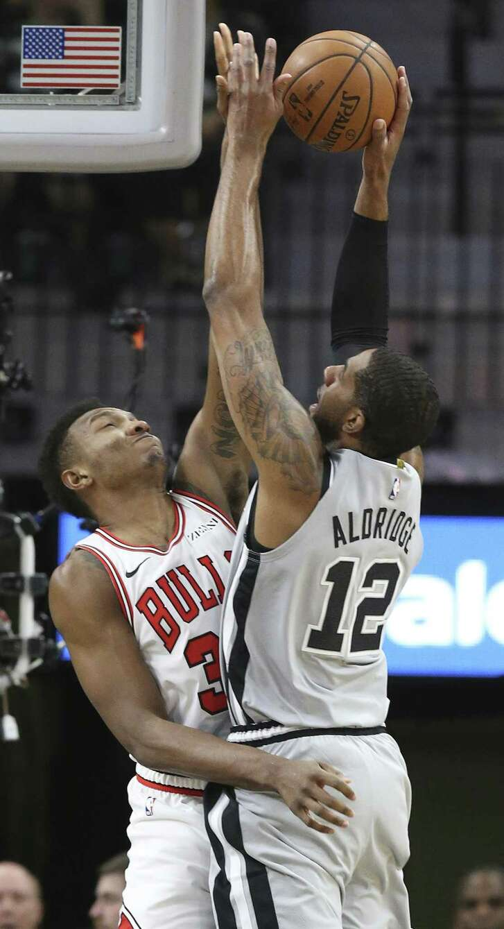LaMarcus Aldridge runs into tough defense from Wendell Carter as the Spurs host the Bulls at the AT&T Center on December 15, 2018.