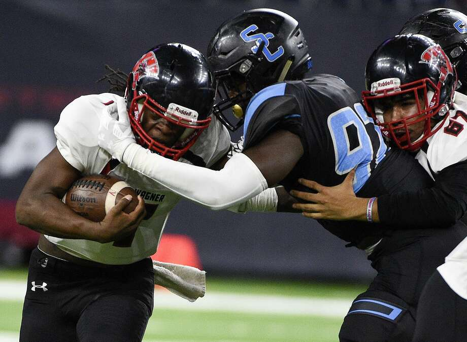 Shadow Creek defensive lineman Alec Bryant, right, tackles Wagner quarterback Javion Ray during the first half of a 5A Division 1 state semifinal Saturday at NRG Stadium in Houston. Wagner finished the season 13-2. Photo: Eric Christian Smith / Contributor