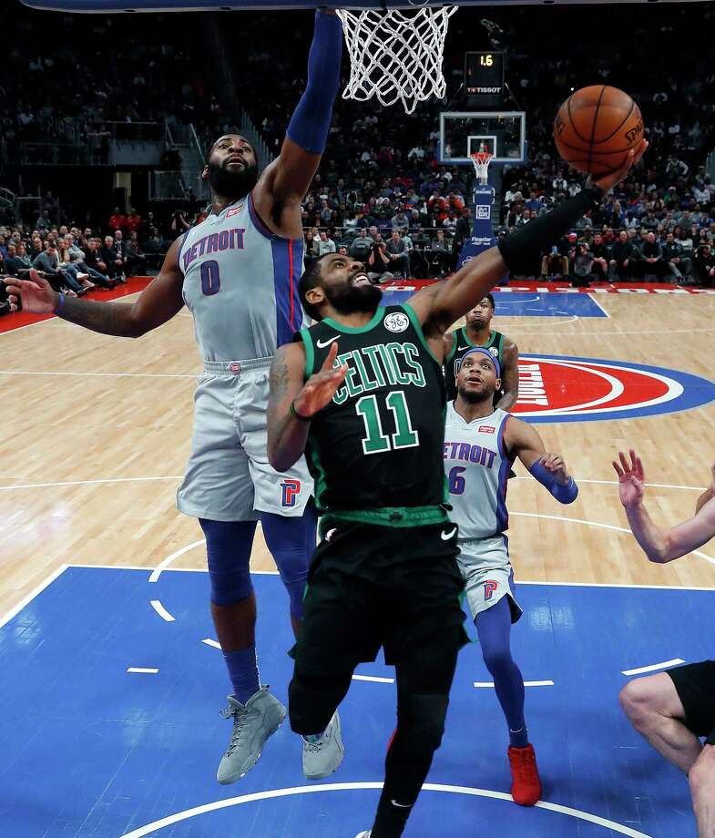 Boston Celtics guard Kyrie Irving (11) drives on Detroit Pistons center Andre Drummond (0) in the second half of an NBA basketball game in Detroit, Saturday, Dec. 15, 2018. (AP Photo/Paul Sancya) Photo: Paul Sancya / Copyright 2018 The Associated Press. All rights reserved