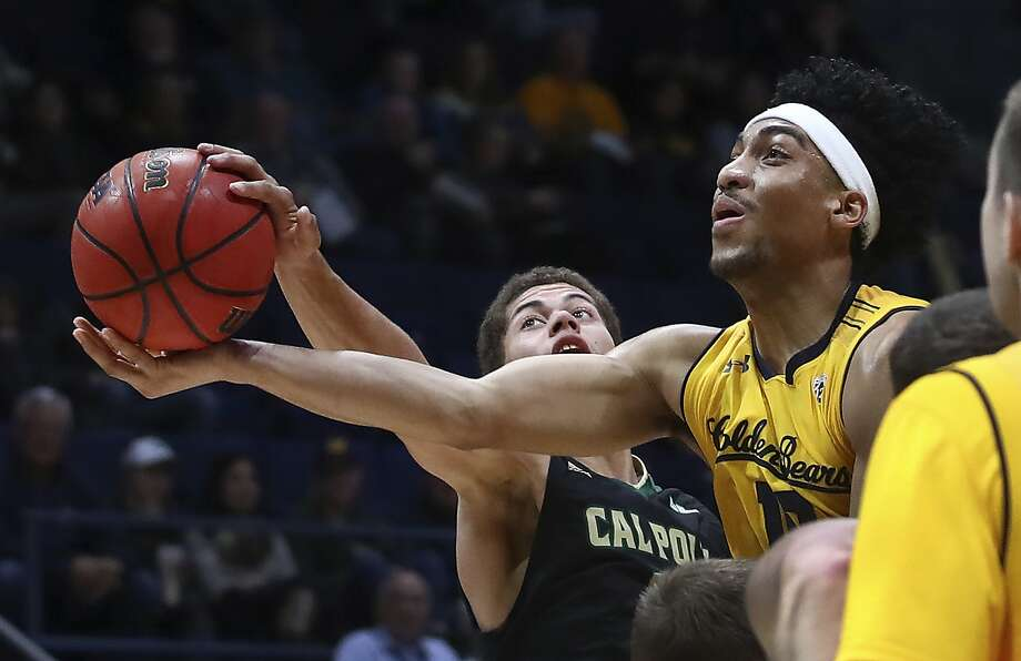 California's Justice Sueing, right, shoots against Cal Poly guard Mark Crowe in the first half of an NCAA college basketball game Saturday, Dec. 15, 2018, in Berkeley, Calif. (AP Photo/Ben Margot) Photo: Ben Margot / Associated Press