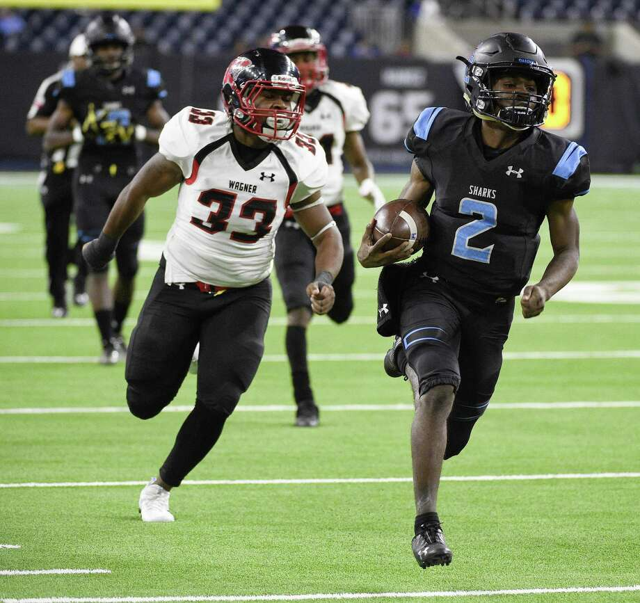 Shadow Creek quarterback Jamarion George, right, runs past Wagner linebacker Michael Turbin for a touchdown during the second half. Shadow Creek faces Dallas Highland Park for the title. Photo: Eric Christian Smith / Contributor