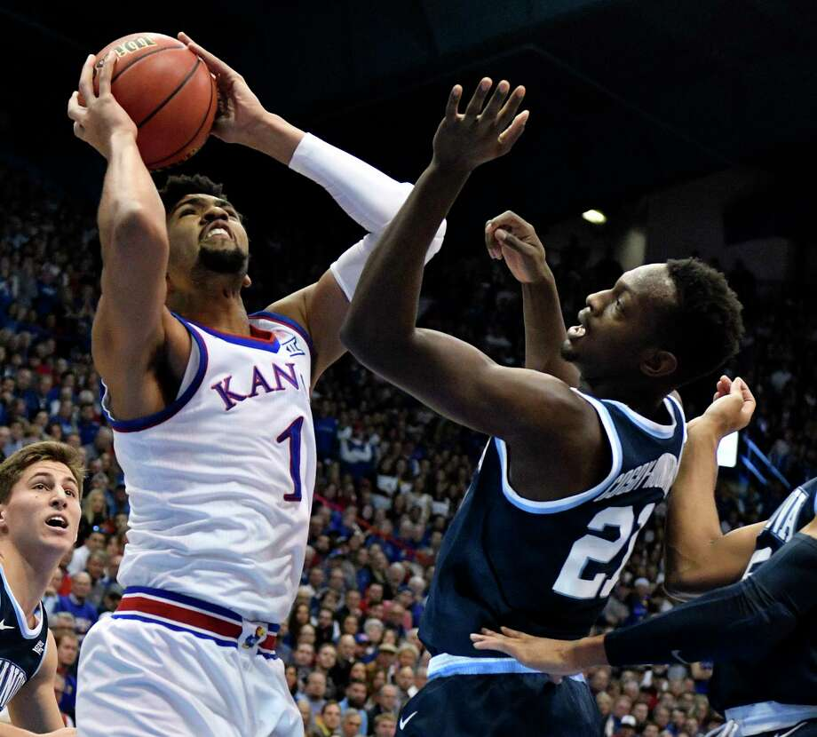 LAWRENCE, KANSAS - DECEMBER 15: Dedric Lawson #1 of the Kansas Jayhawks tries to shoot against Dhamir Cosby-Roundtree #21 of the Villanova Wildcats in the first half at Allen Fieldhouse on December 15, 2018 in Lawrence, Kansas. (Photo by Ed Zurga/Getty Images) Photo: Ed Zurga / 2018 Getty Images