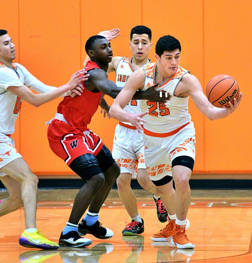 Elian Fernandez steals the ball Saturday from a Wagner player. Fernandez and the Longhorns allowed only four points in the second quarter on their way to upsetting the No. 5 Thunderbirds 77-55 at home. Photo: Cuate Santos / Laredo Morning Times / Laredo Morning Times
