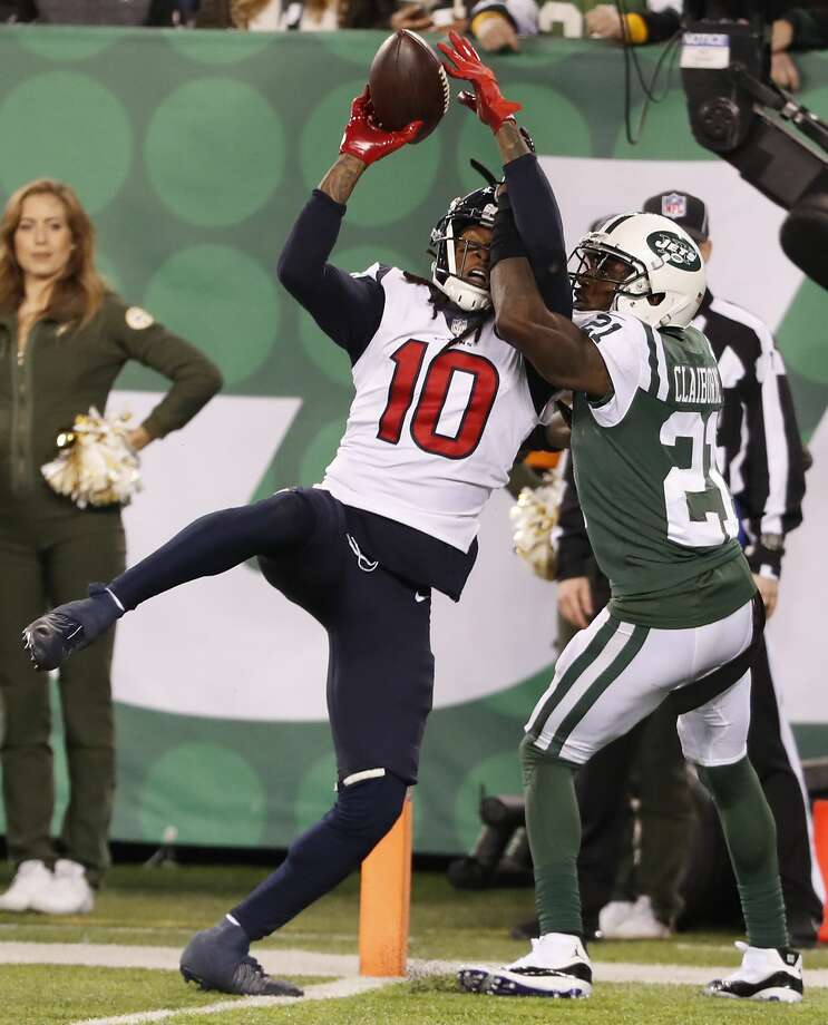 Houston Texans wide receiver DeAndre Hopkins (10) beats New York Jets cornerback Morris Claiborne (21) for a 14-yard touchdown reception during the fourth quarter of an NFL football game at MetLife Stadium on Saturday, Dec. 15, 2018, in East Rutherford, N.J. Photo: Brett Coomer/Staff Photographer