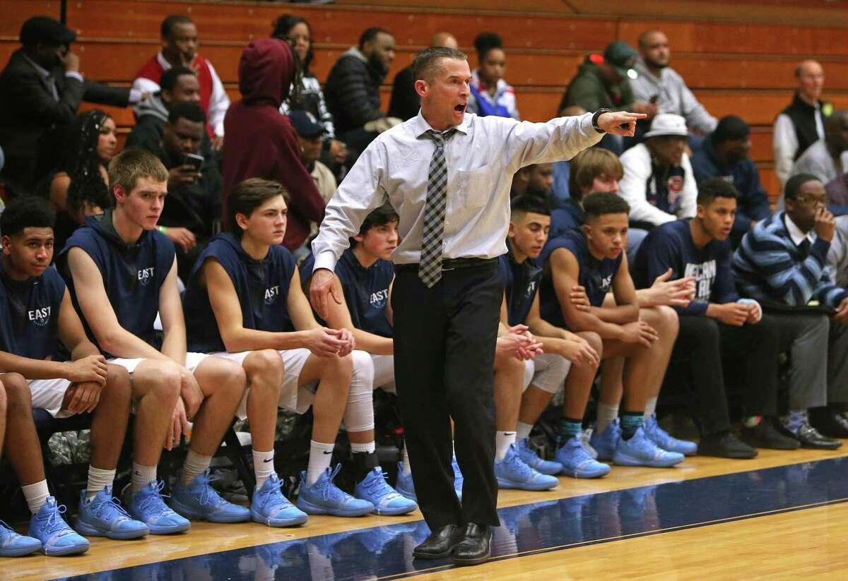 East Catholic High School boys basketball head coach Luke Reilly yells from the sideline during the GHPA High School Basketball Classic against Hillhouse High School at Trinity College in Hartford on Saturday, Dec. 15, 2018.