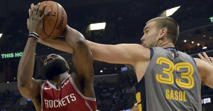 Houston Rockets guard James Harden (13) controls the ball against Memphis Grizzlies center Marc Gasol (33) in the first half of an NBA basketball game Saturday, Dec. 15, 2018, in Memphis, Tenn. (AP Photo/Brandon Dill)