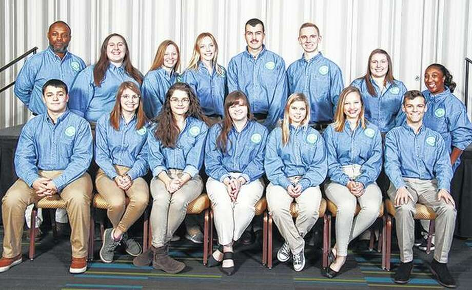 "Anne Becker (front row, center) of Jacksonville was among 13 University of Illinois Extension 4-H teens who recently attended the five-day National 4-H Congress in Atlanta. The teens received the State 4-H Award, and the Illinois 4-H Foundation provided support for the youths to attend the national conference as part of that recognition. Among the speakers at the conference was John Beede, who has climbed Mount Everest and challenged the delegates, saying, ""The mountains will never lower themselves to your level; you must rise up to the demands presented to you by the climb."" Other 4-H members attending from Illinois were Brady Haring (front row, from left) of Elizabeth, Lydia Widener of Normal, Nalia Warmack of Marseilles, Becker, Daria Cleland of Capron, Grace Betz of Oak Lawn, Craig Logan of Altamont; chaperone Leonard Parker (back row, from left) of Cook County, Lindy Couch of Geneseo, Evelyn Martin of Newark, Abigail Steffens of Lincoln, Bradley Bruhl of LeRoy, Joshua Rossi of Morris, Katherine Mueller of Peoria, and chaperone Erica Austin of Sangamon County. Photo: Photo Provided"