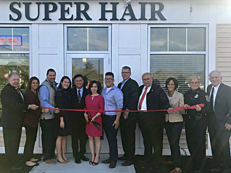 Super Hair and Nail Spa held a grand opening at its new location, 25 Shunpike Road, Cromwell Oct. 17. The Middlesex Chamber celebrated with Owner Peter Nguyen, his family and team, along with Chamber Chairman Jay Polke, state Rep. Christie Carpino, Mayor Enzo Faienza, Cromwell Division Chair Rodney Bitgood, Town Manager Anthony Salvatore, Councilwoman Samantha Slade, Police Chief Denise Lamontagne and Chamber President Larry McHugh. Photo: Contributed Photo