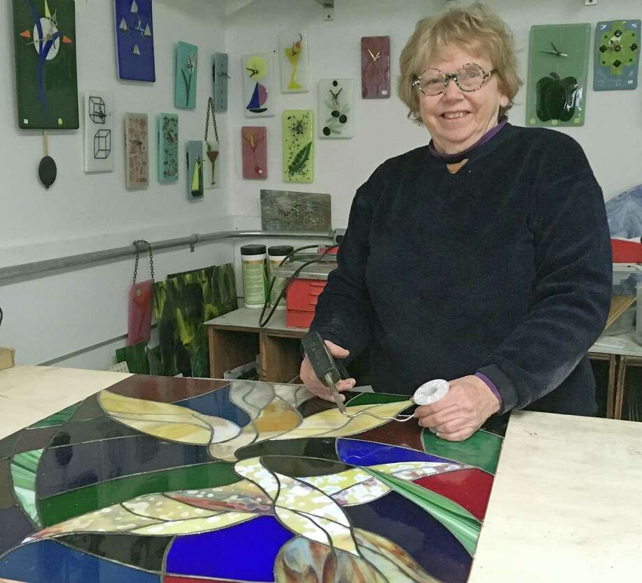 Glass artist Jayne Crowley in her studio. Photo: Contributed Photo / New Haven Register contributed