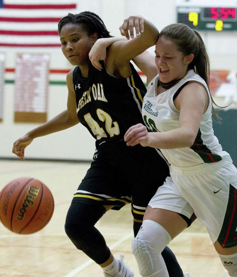 Klein Oak forward Dylan Malone (42) and The Woodlands guard Kate Frank (10) fight for a loose ball during the second quarter of a District 15-6A high school girls basketball game at The Woodlands High School, Saturday, Dec. 8, 2018, in The Woodlands. Photo: Jason Fochtman, Houston Chronicle / Staff Photographer / © 2018 Houston Chronicle