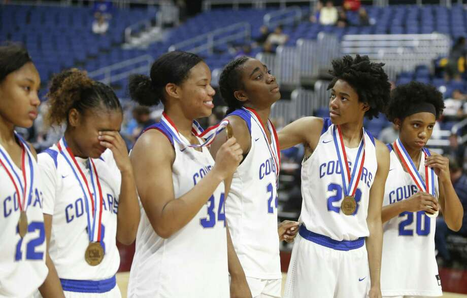 Cypress Creek at the end of the game as they get their medals. Plano v Cypress Creek in a UIL girls basketball Class 6A on Friday, March 2, 2018 at the Alamodome. (Ronald Cortes/Special Contributor) f Photo: Ronald Cortes, Special Contributor / Ronald Cortes / 2018 Ronald Cortes