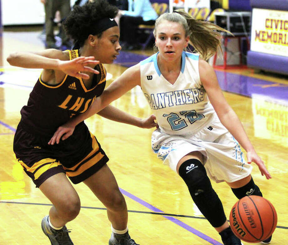 Jersey's Clare Breden (right) drives on Lutheran North's Taleah Dilworth during the first half Saturday night at the CM/Adidas Shootout at CM High School in Bethalto. Photo: Greg Shashack / The Telegraph