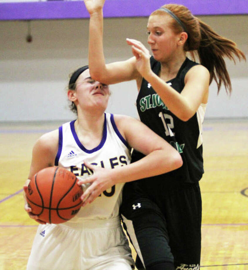 CM's Anna Hall (left) is fouled by St. Joe's Allie Westphale while putting up a shot Saturday in the CM/Adidas Shootout in Bethalto. Hall made the shot and converted the three-point play. Photo: Greg Shashack / The Telegraph