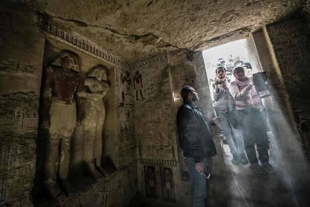 Visitors entering the tomb at the Saqqara necropolis on Saturday.