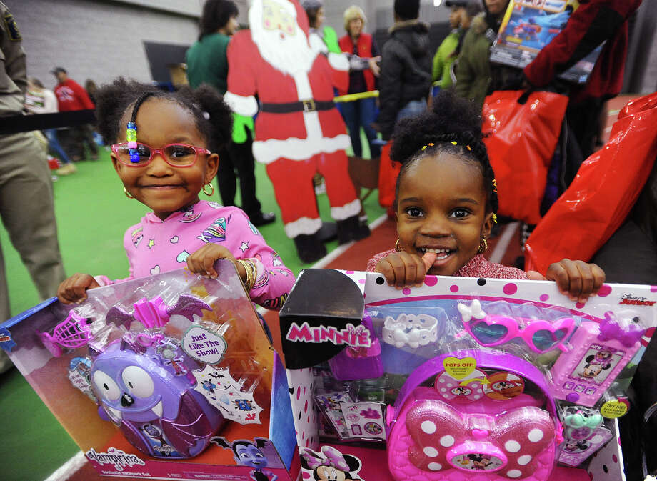 R-Mani Johnson, 3, left, and Aloni Harmon, 2, of New Haven, with their toys at the 5th Annual Winter Wonderland holiday toy giveaway at the Floyd Little Fieldhouse in New Haven, Conn. on Sunday, December 16, 2018. Photo: Brian A. Pounds, Hearst Connecticut Media / Connecticut Post