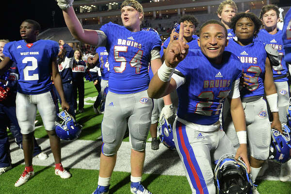 West Brook's Bruins celebrate after defeating Austin Westlake 35 - 30 in the Class 6A state semifinals at Legacy Stadium. Photo taken Saturday, December 15, 2018 Kim Brent/The Enterprise