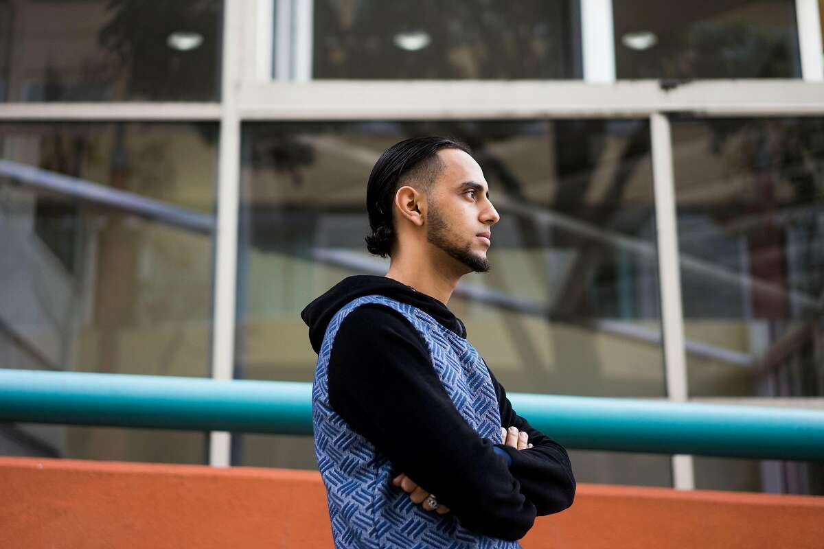 Ali Hassan poses for a photograph at UCSF Children's Hospital in Oakland, Calif. where his son is in the ICU on Sunday, Dec. 16, 2018. Hassan's wife, who is in Yemen, is unable to see their dying son due to the travel ban from the seven majority Muslim countries.