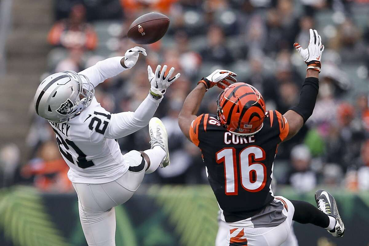 Oakland Raiders cornerback Gareon Conley (21) misses a pass contested by Cincinnati Bengals wide receiver Cody Core (16) in the second half of an NFL football game, Sunday, Dec. 16, 2018, in Cincinnati.