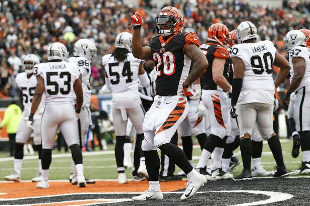 Cincinnati Bengals running back Joe Mixon (28) celebrates his touchdown in the first half of an NFL football game against the Oakland Raiders, Sunday, Dec. 16, 2018, in Cincinnati. (AP Photo/Frank Victores)