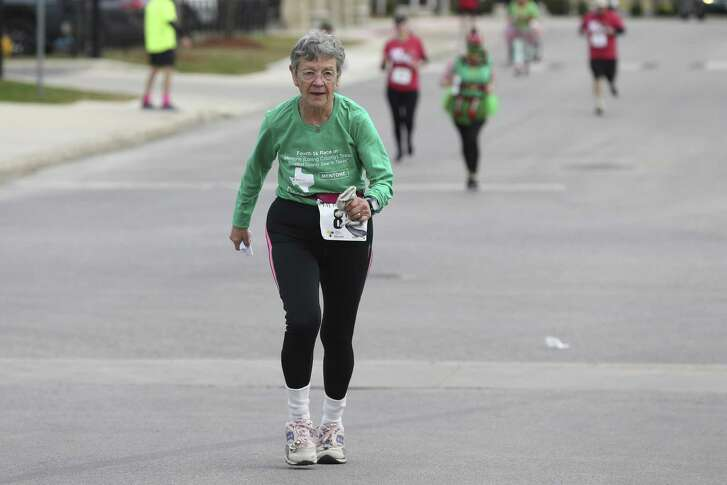 Mary Kaplan, 79, participates in the Elf Run 5K in San Antonio, Sunday, Dec. 16, 2018. Kaplan started running at the age of 43 and has participated in 5K runs in every Texas County and every state.