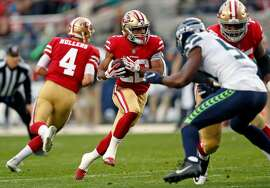 San Francisco 49ers' Matt Breida rushes in 2nd quarter against Seattle Seahawks during NFL game at Levi's Stadium in Santa Clara, Calif. on Sunday, December 16, 2018.