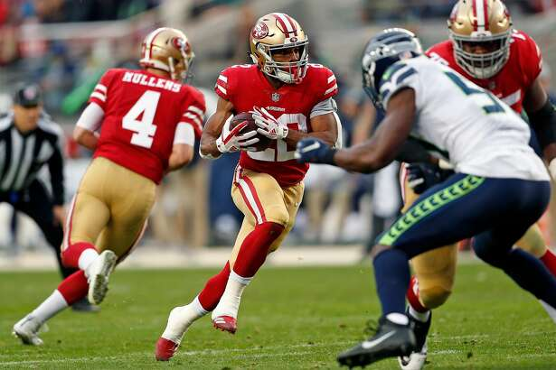 San Francisco 49ers' Matt Breida rushes in 2nd quarter against Seattle Seahawks during NFL game at Levi's Stadium in Santa Clara, Calif. on Sunday, December 16, 2018.