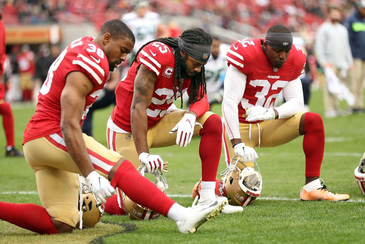 San Francisco 49ers' Antone Exum, Jr. (38), Richard Sherman (25) and D.J. Reed, Jr. (32) react to Ahkello Witherspoon's injury in 1st quarter against Seattle Seahawks during NFL game at Levi's Stadium in Santa Clara, Calif. on Sunday, December 16, 2018.