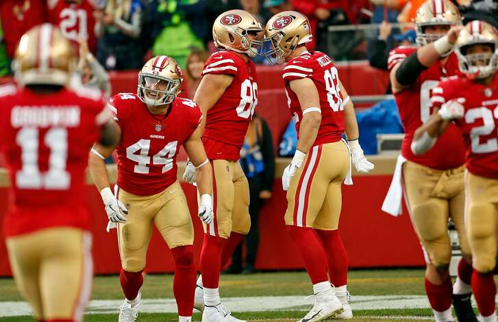 San Francisco 49ers' Garrett Celek (88) celebrates his 2nd quarter touchdown with teammates while playing Seattle Seahawks during NFL game at Levi's Stadium in Santa Clara, Calif. on Sunday, December 16, 2018.