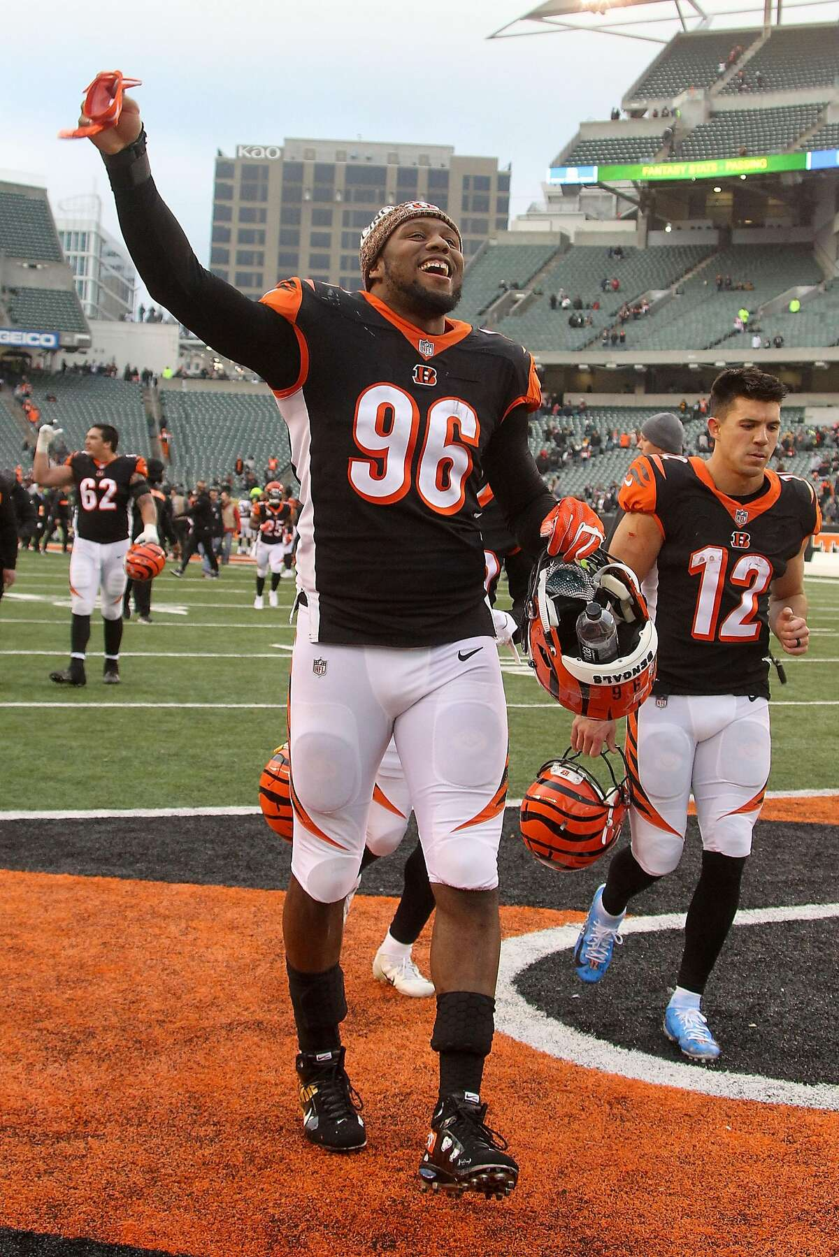 CINCINNATI, OH - DECEMBER 16: Carlos Dunlap #96 of the Cincinnati Bengals celebrates while walking off of the field after the end of the game against the Oakland Raiders at Paul Brown Stadium on December 16, 2018 in Cincinnati, Ohio. Oakland defeated Cincinnati 30-16. (Photo by John Grieshop/Getty Images)