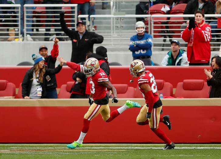 San Francisco 49ers' Richie James, Jr. (13) celebrates his kick off return for a touchdown in 1st quarter against Seattle Seahawks during NFL game at Levi's Stadium in Santa Clara, Calif. on Sunday, December 16, 2018.