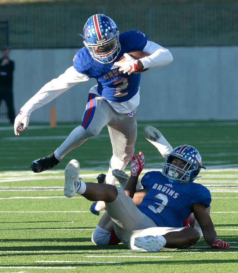 West Brook's Deonte Simpson leaps over Austin Westlake's  tackle efforts in the Class 6A state semifinals at Legacy Stadium. Photo taken Saturday, December 15, 2018 Kim Brent/The Enterprise Photo: Kim Brent/The Enterprise