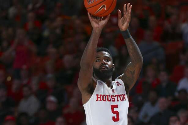 Houston Cougars guard Corey Davis Jr. (5) shoots a three point basket against the Saint Louis Billikens during the second half of an NCAA basketball game at the Fertitta Center Sunday, Dec. 16, 2018, in Houston. The Cougars won 68-64.