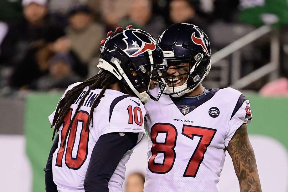 EAST RUTHERFORD, NJ - DECEMBER 15: Wide receiver DeAndre Hopkins #10 of the Houston Texans celebrates his touchdown with teammate wide receiver Demaryius Thomas #87 during the second quarter against the New York Jets at MetLife Stadium on December 15, 2018 in East Rutherford, New Jersey. The Houston Texans won 29-22. (Photo by Steven Ryan/Getty Images) Photo: Steven Ryan, Stringer / Getty Images / 2018 Getty Images