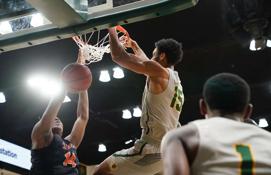 University of San Francisco's Nate Renfro dunks the ball against Cal State Fullerton defense at the War Memorial Gymnasium in San Francisco, Calif. on Sunday, Dec 16, 2018. Photo: Chris M. Leung / USF Athletics / chrismleungphoto