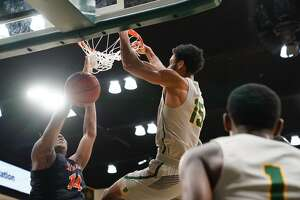 University of San Francisco's Nate Renfro dunks the ball against Cal State Fullerton defense at the War Memorial Gymnasium in San Francisco, Calif. on Sunday, Dec 16, 2018.