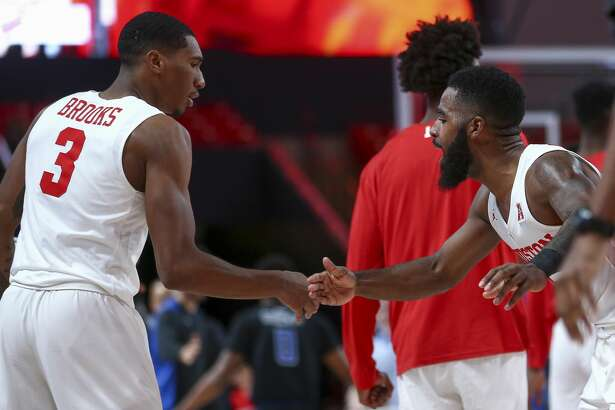 Houston Cougars guard Armoni Brooks (3) celebrates with guard Galen Robinson Jr. (25) after sinking a three point basket against the Saint Louis Billikens during the second half of an NCAA basketball game at the Fertitta Center Sunday, Dec. 16, 2018, in Houston. The Cougars won 68-64.