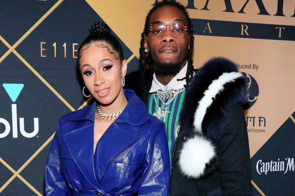 FILE- In this Feb. 3, 2018, file photo, Cardi B, left, and Offset arrive at the Maxim Super Bowl Party at the Maxim Dome in Minneapolis. Cardi B is asking the public to not bash Offset, who became the target of internet outrage after he interrupted her set at the Rolling Loud Festival in Los Angeles Saturday night, Dec. 15, 2018 and asked her to get back together with him. (Photo by Omar Vega/Invision/AP, File)