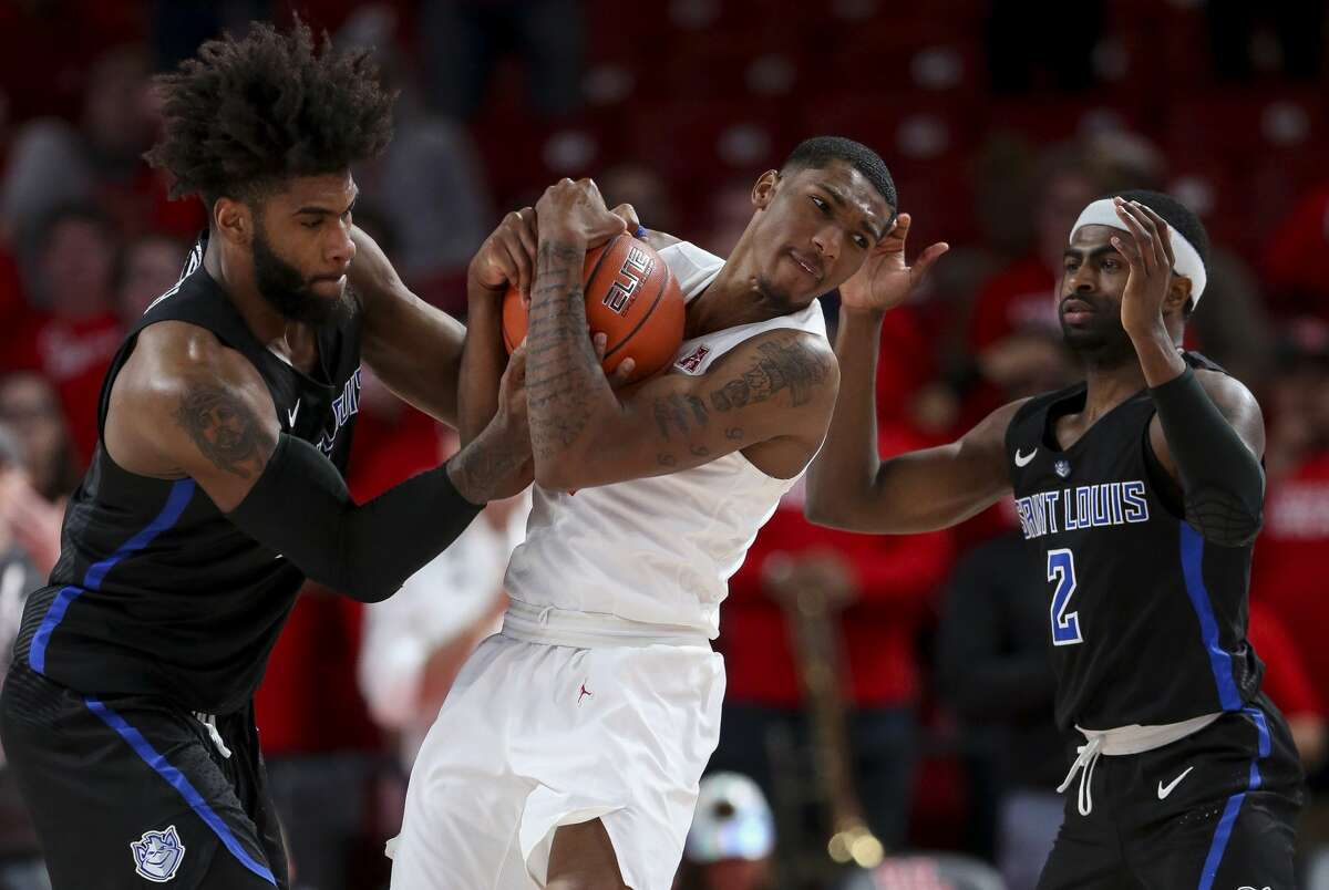 Houston Cougars guard Armoni Brooks (3) recovers a loose ball against Saint Louis Billikens forward Hasahn French (11) and guard Tramaine Isabell Jr. (2) during the second half of an NCAA basketball game at the Fertitta Center Sunday, Dec. 16, 2018, in Houston. The Cougars won 68-64.