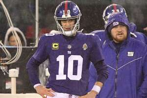 Giants quarterback Eli Manning reacts late in his team's loss to the Titans on Sunday.