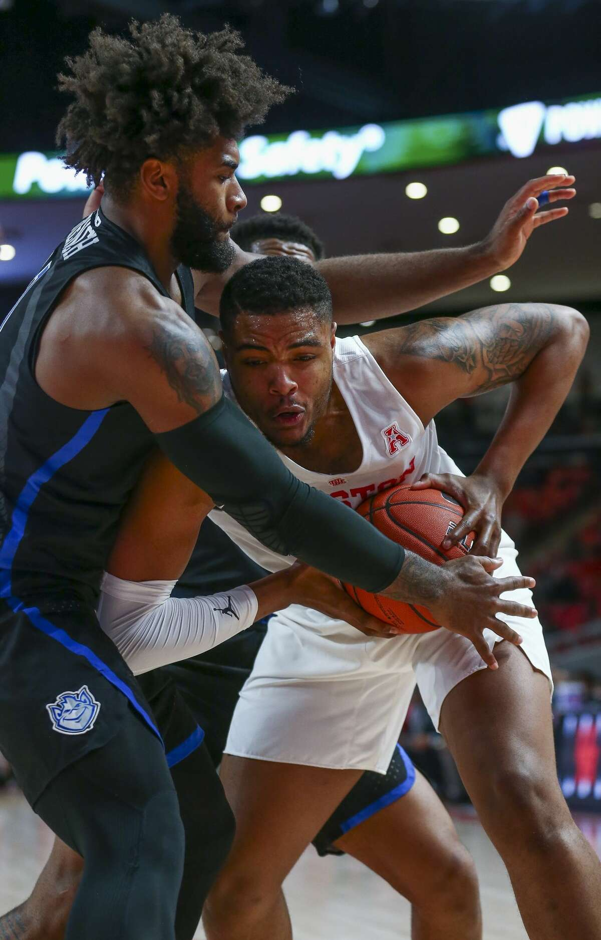 Houston Cougars forward Brison Gresham (55) shields the ball away from Saint Louis Billikens forward D.J. Foreman (1) during the first half of an NCAA basketball game at the Fertitta Center Sunday, Dec. 16, 2018, in Houston.